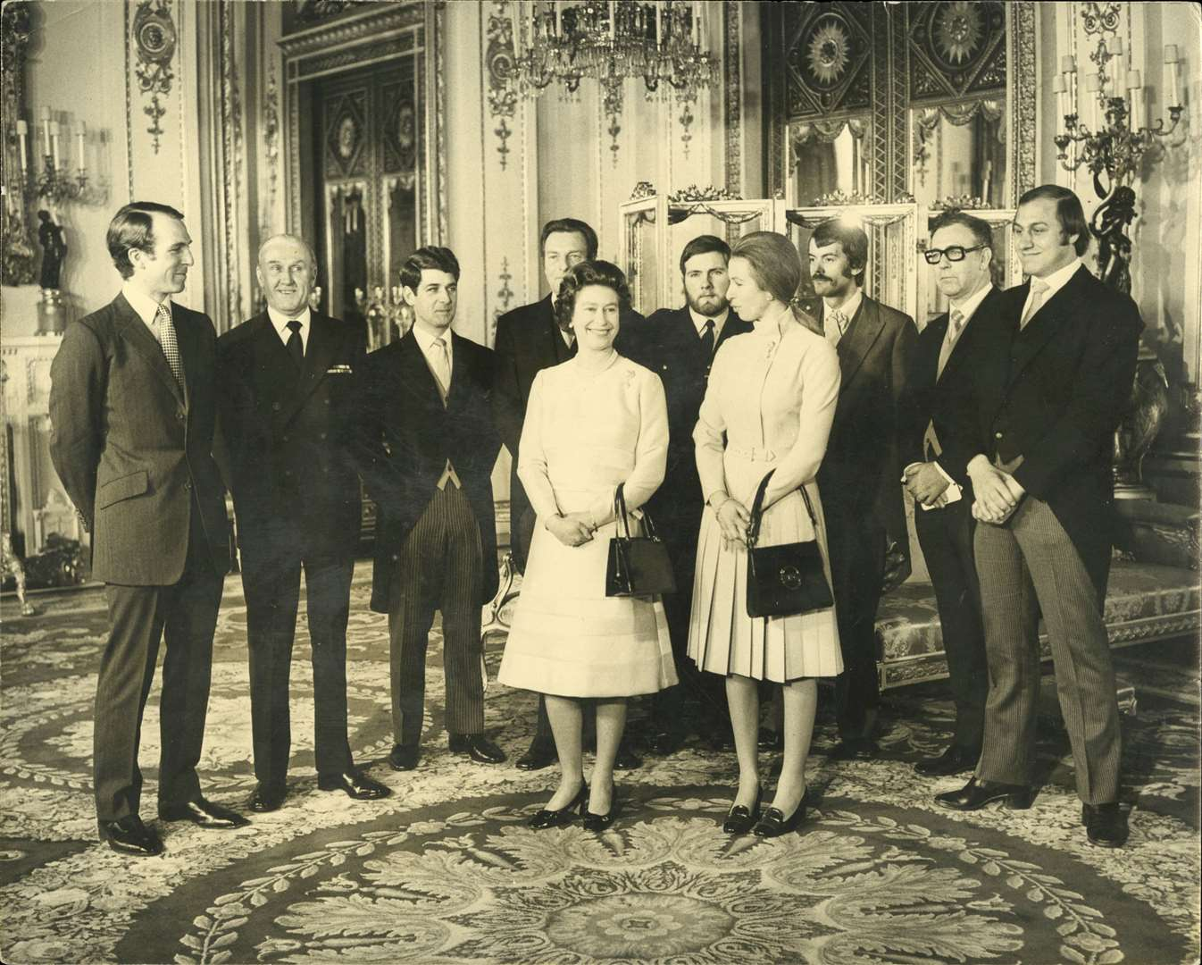 Ronnie Russell (far right) with Princess Anne, Queen Elizabeth and a group of people who had a part to play in foiling the kidnap attempt. Picture: Dix Noonan Webb