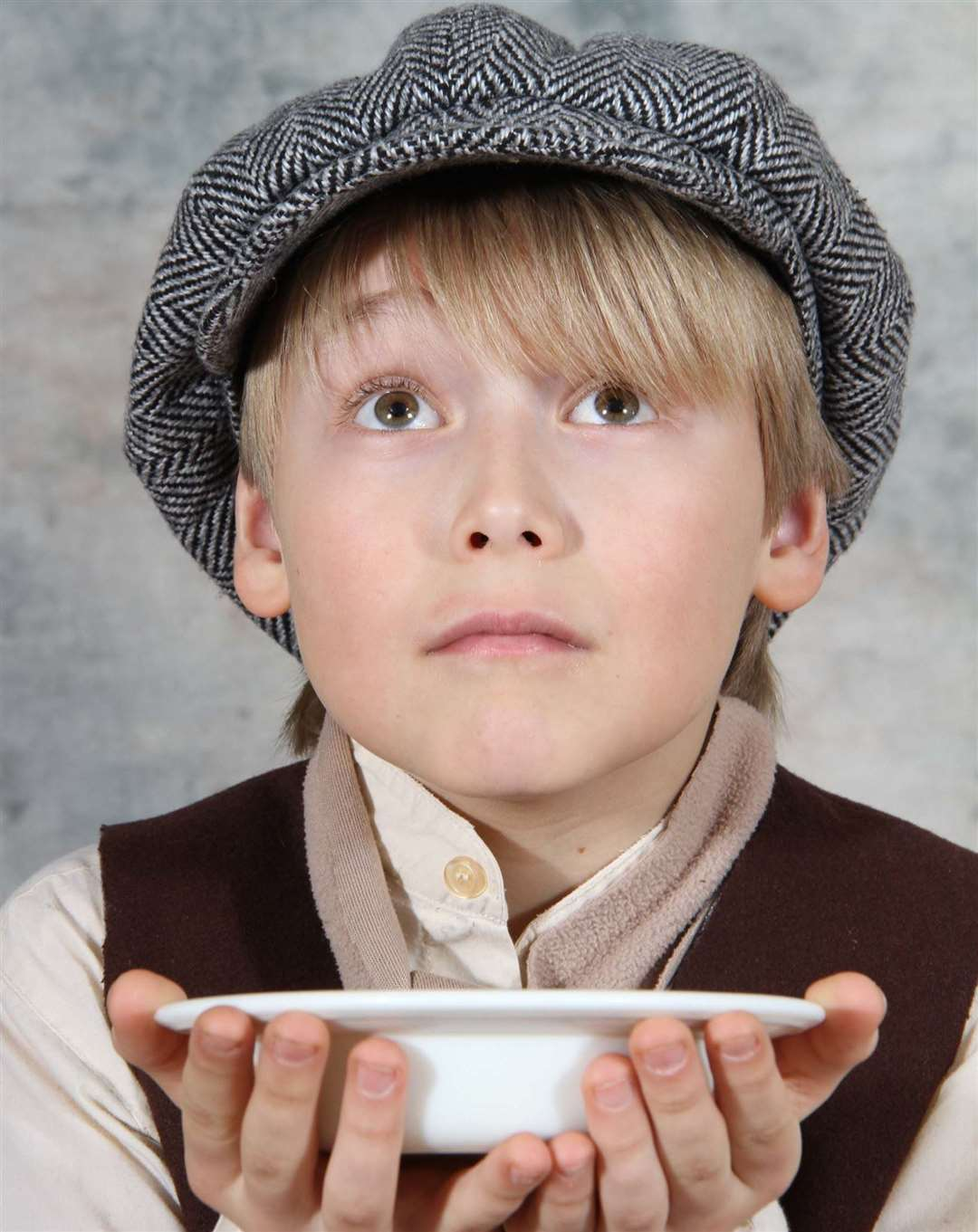 A young Tyler Rodberg, 11, paying the lead role of Oliver Twist at the Woodville Halls in 2012. Stock Picture: Roger Vaughan
