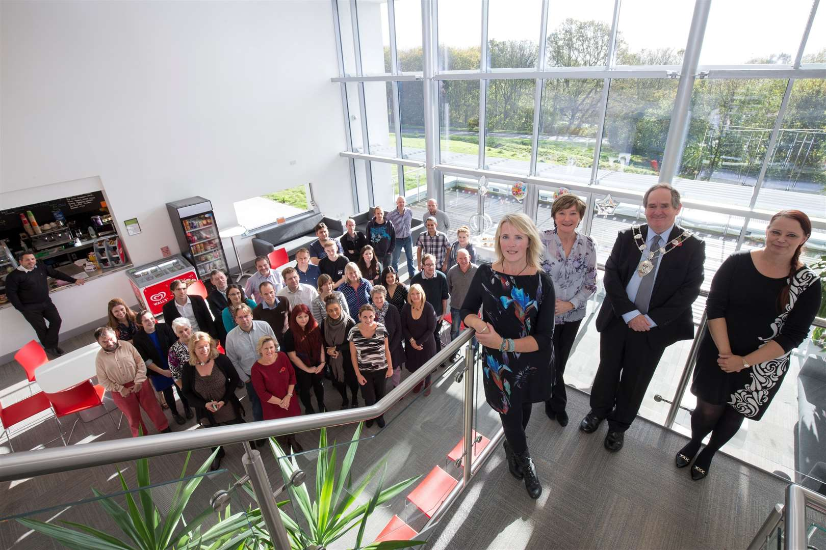 Staff at the Canterbury Innovation Centre and, on the stairs, from left, centre manager Jo Clark, assistant centre manager Tracy Blazey, Sheriff of Canterbury Cllr Tony Austin and Debbie Spalding, East Kent Spatial Development Company